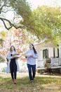 Caucasian couple walking in backyard