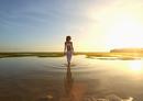 Pacific Islander woman walking in rippling water