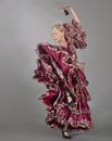 Caucasian woman dancing in ornate dress
