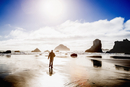 Caucasian man walking on beach