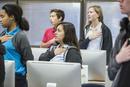 Students reciting Pledge of Allegiance in classroom