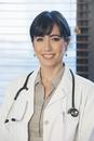 Hispanic doctor smiling in hospital