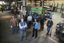 High angle view of workers standing in workshop
