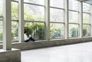 Hispanic businessman sitting in office window