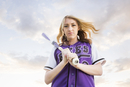 Caucasian teenage girl wearing softball uniform