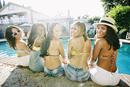 Women sitting at swimming pool