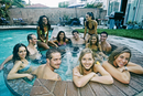 Friends relaxing in hot tub