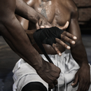 Trainer wrapping African boxer