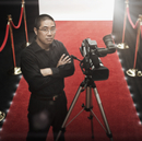 Chinese cameraman on red carpet with camera
