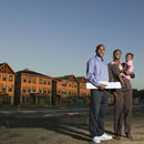 family at residential construction site