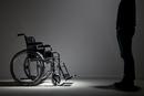 Caucasian man approaching wheelchair