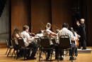 Student orchestra playing on stage