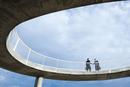 Caucasian businessmen shaking hands on elevated walkway