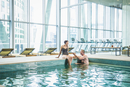 Couple relaxing in swimming pool