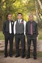 Teenage boys smiling before prom