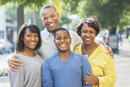 African American family smiling in city