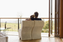 Caucasian couple lounging on balcony