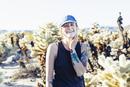 Caucasian woman smiling in desert field