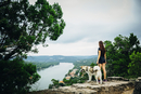 Caucasian woman and dog admiring scenic view