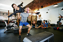 Couple working out in gymnasium