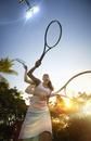 Multiple exposures of Pacific Islander woman playing tennis