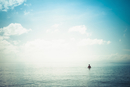 Hispanic woman swimming in ocean