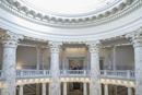 Caucasian couple touring capitol building