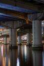 Highway overpass pillars in urban river