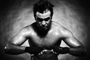 Caucasian boxer athlete flexing his muscles