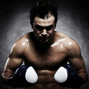 Caucasian boxer flexing his muscles