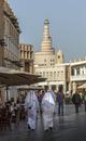 Men walking on Doha street, Doha, Qatar