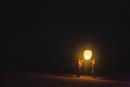 Mixed race women flying lantern at night