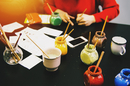 High angle view of artist and paint pots