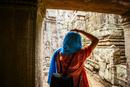 Woman exploring ruins at Angkor Wat, Siem Reap, Cambodia