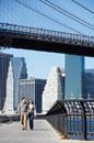 Couple walking under Brooklyn Bridge