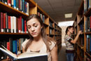 Two female students in library