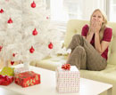 Excited Woman by Christmas Tree