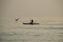 Man kayaking in sea