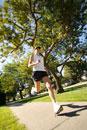 Woman jogging on suburb sidewalk