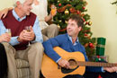Man playing guitar for father