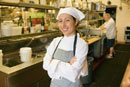 Hispanic female chef smiling in kitchen