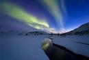 Aurora Borealis over Skittendalen Valley, Troms County, Norw