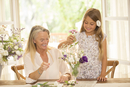 Grandmother and granddaughter arranging flowers