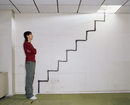 Man looking at a spray painted stairway
