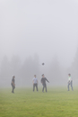Sweden, Vastmanland, Teenage boys (14-15, 16-17) playing soccer in fog