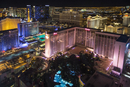 High angle view of Las Vegas at night, with the illuminated Flamingo hotel and casino in the foreground.