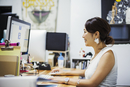 Design Studio. A woman sitting at a desk using a computer.