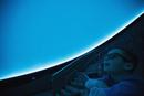 Curious boy enjoying planetarium show