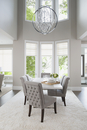 Vaulted ceiling chandelier hanging over elegant dining table