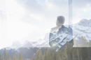 Digital composite businessman at window looking at mountains